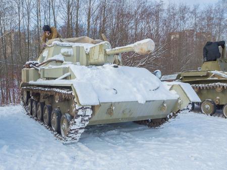 Russia, Saint-Petersburg, 24 February 2017, reconstruction - the driver-mechanic prepares tank su-76 maneuvers.