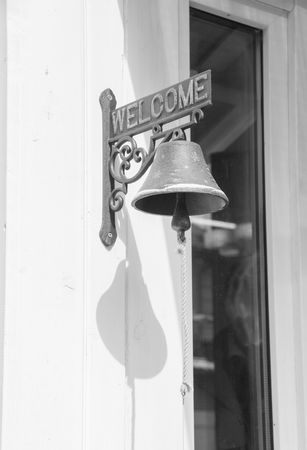 black and white, the bell at the door instead of calling. Stock Photo