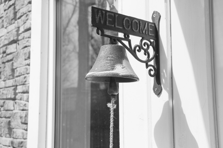 black and white, a door bell to call the owner.