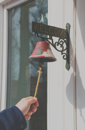 hand ringing the bell at the door instead of calling.