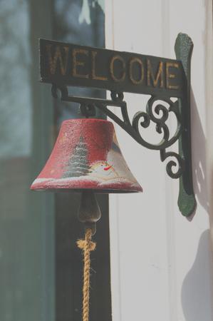 door bell with an inscription welcome. 版權商用圖片