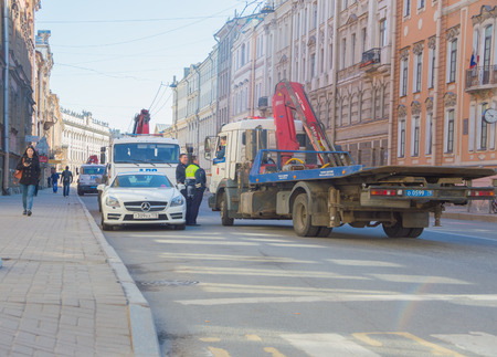 Russia, Saint-Petersburg, 3 may 2017 - several cars tow police near the Mercedes.