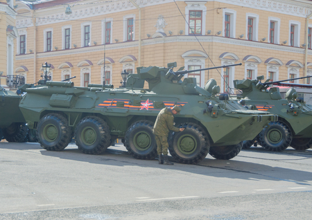 Russia, St. Petersburg, 7 may 2017, the rehearsal of the victory parade soldiers paint brush-wheel armored personnel carriers.