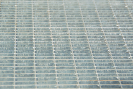 background, texture, square steel grille closeup. 版權商用圖片