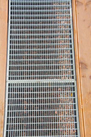 steel grille in the wooden flooring. 版權商用圖片