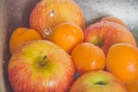 closeup of apples and peaches with drops of water. Stock Photo