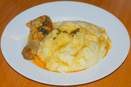 chicken leg with mashed potatoes and gravy in the plate. Stock Photo