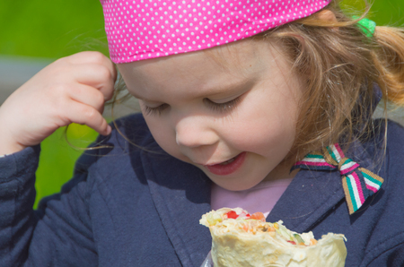 closeup of a child eating in the Park.