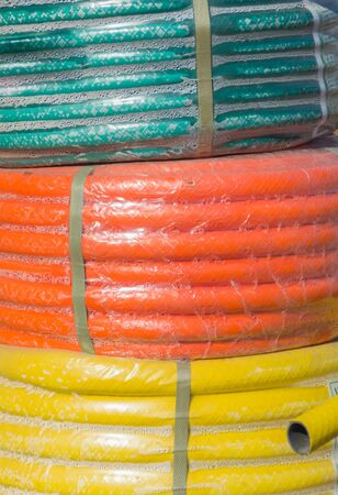 sold colored watering hoses.