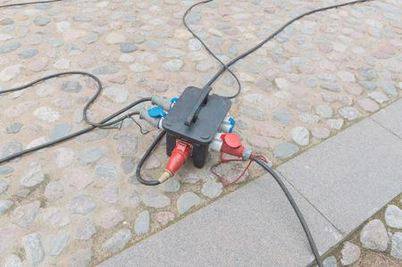 powerful hooks extension cords near a historic building. Banco de Imagens