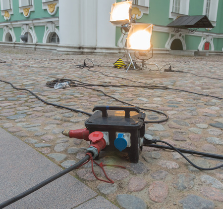 in the courtyard of the old building are powerful hooks extension cords Фото со стока - 81222810