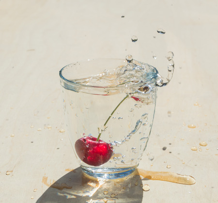 cherry and splash in the clear glass of water.