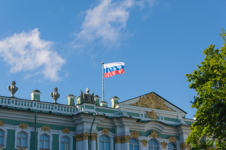 the Russian Federation flag flies over the building.