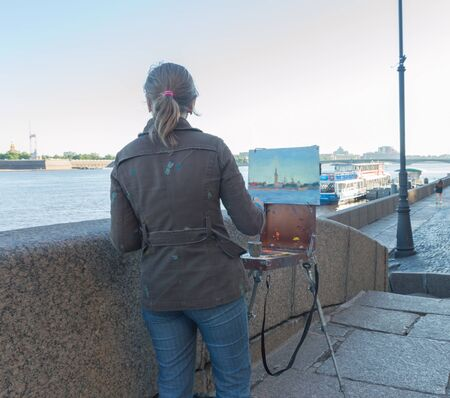 on the waterfront draws a picture of a girl artist.