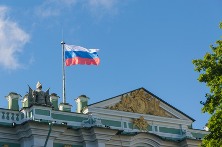 over the building develops in the wind the flag of Russia.