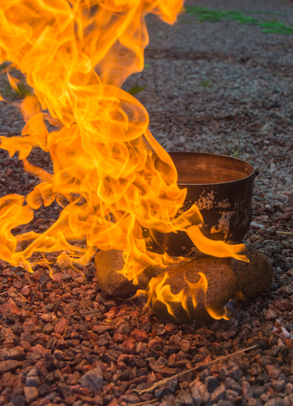 burn with a bright flame stones and camp pot.