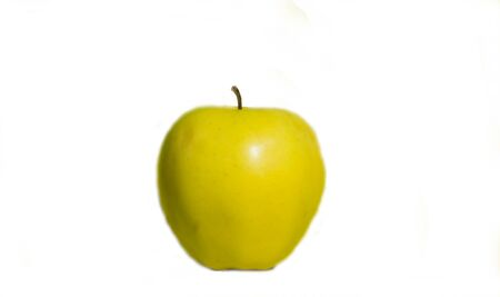 on white background yellow Apple, close up.