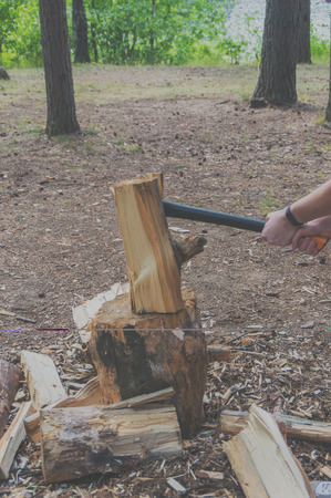 axe for splitting firewood in his hands.