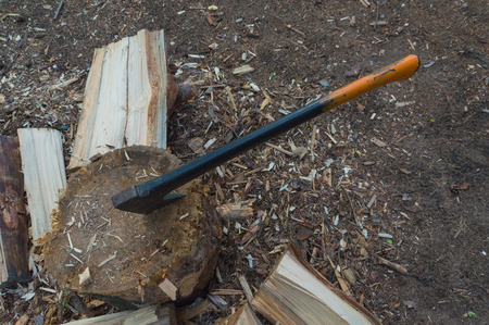 in the stump stuck a hatchet for splitting firewood. Stock Photo - 82944969