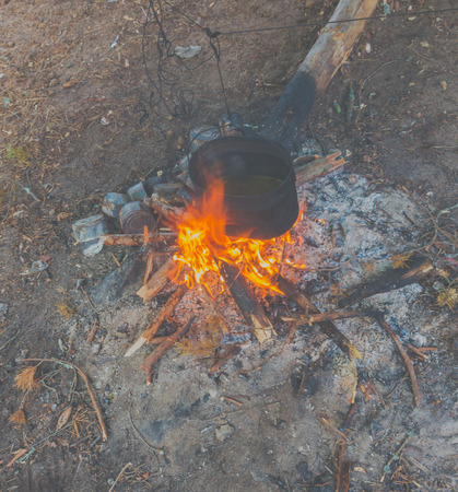 a pot of water over the fire in the campaign.