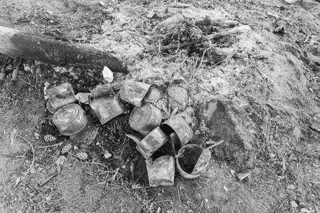 the burnt cans near a fire. Stock fotó