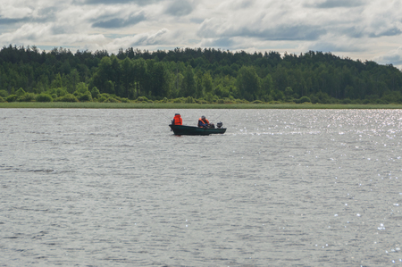 Two fisherman in a boat caught in the trap.