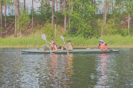 July 15, 2017 Russia, the Vuoksi river, Losevo - a group of people floating in a kayak.