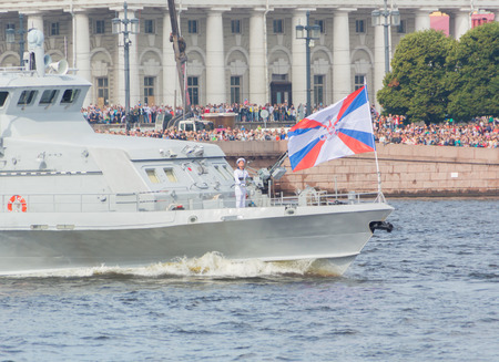 Russia, Saint-Petersburg, July 30, 2017 - on the nose of the ship a sailor with a gun.