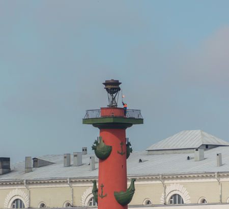 Russia, Saint-Petersburg, July 30, 2017 worker sets fire to the Rostral column on the day of the Navy .