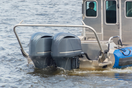 powerful outboard motors at the stern of the speed boat.