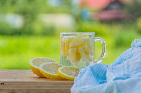 summer drink water with lemon on the table. Stock fotó