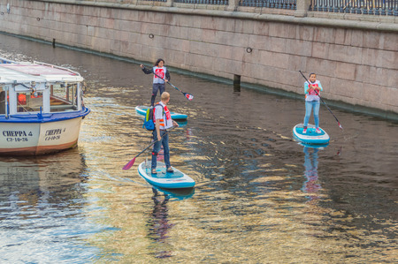 Russia, Saint-Petersburg, 14 Aug 2017 - a group of young people on SIP-surfing.