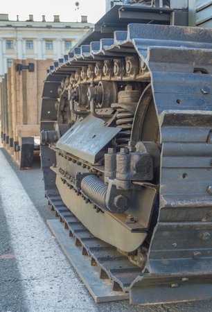 closeup of the mechanism of a caterpillar tractor.