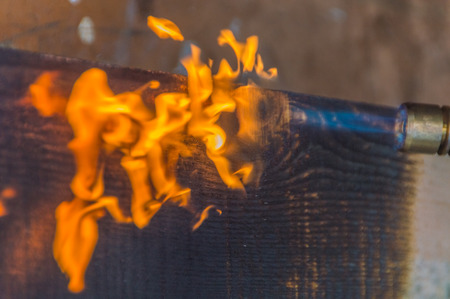 processing of wood, fire from a gas burner.