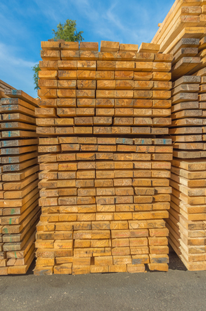 boards for building, stacked in a pile.