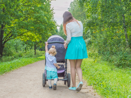 walking stroller pushing child. Stock Photo