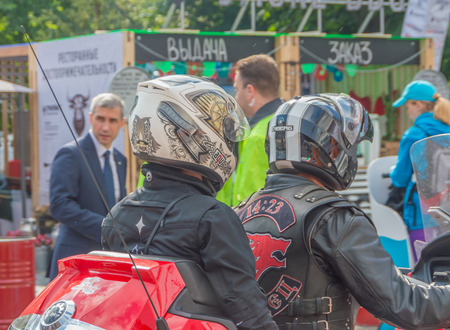 Russia, Saint-Petersburg, Ostrovsky square, August 3, 2017 - festival Harley Davidson, protective helmets male and female.