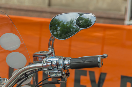Russia, Saint-Petersburg, Ostrovsky square, August 3, 2017 - festival Harley Davidson throttle motorcycle mirror.
