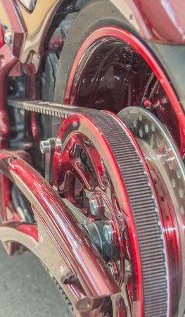 the rear wheel of a motorcycle with a belt transmitting rotation Reklamní fotografie