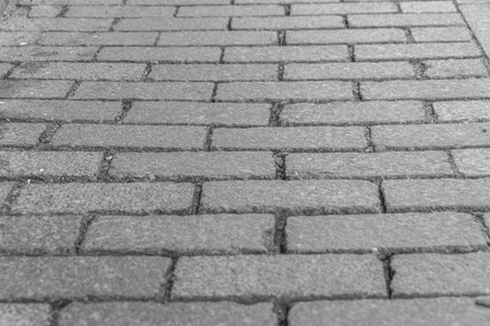 black and white Abstract background of old paved paths closeup