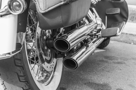 black and white, the engine and the exhaust pipe of a motorcycle Reklamní fotografie