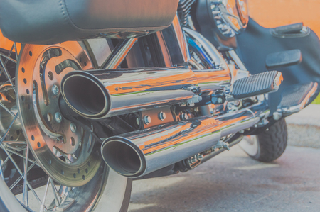 the engine and the exhaust pipe of a motorcycle