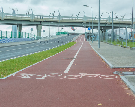 a separate bike path in the city goes under the bridge Stock Photo