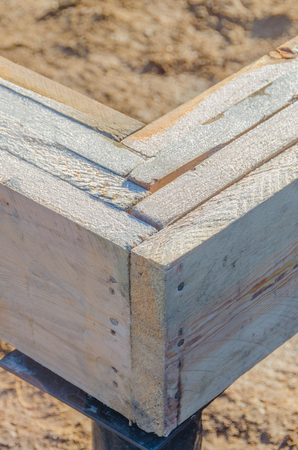 closeup of hewn planks, the timber framing of a house under construction