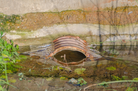 closeup of a blockage in the waste pipe in the open air Stock Photo