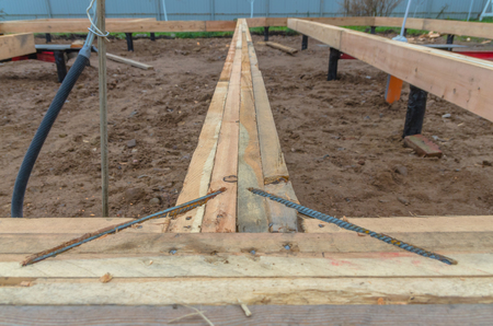the timber framing of a house on pile Foundation Stock Photo