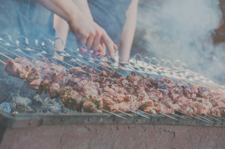 closeup of shish kebab on skewers, the chef prepares Stock Photo