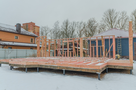 the construction of a wooden house on the country site