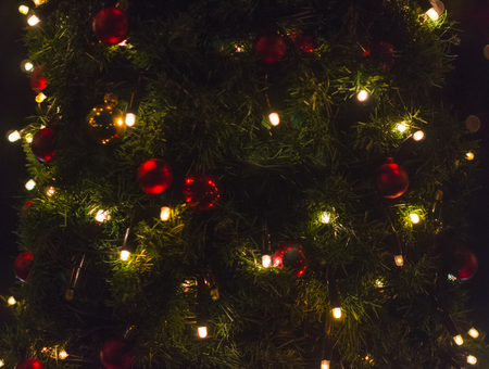 tree decorated with toys at night
