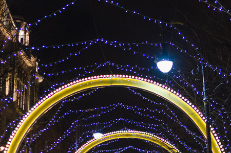 arch of lamps and lights in the night sky